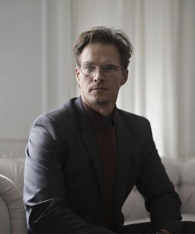 well-dressed-businessman-sitting-on-sofa
