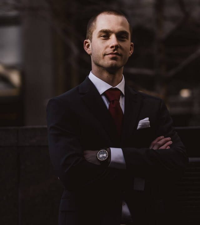 man-wearing-black-notched-lapel-suit-jacket-in-focus